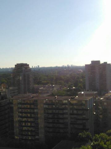 A morning view of the Toronto skyline from the balcony of the condo.