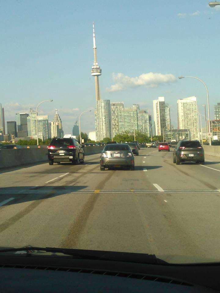 view of CN Tower while driving into the city