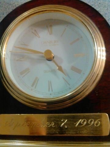 A clock with our wedding date engraved on the base.  I don't think we've changed the battery in the clock since 1996